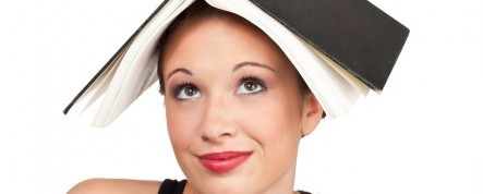 Kozzi-confused-expression-head-shot-with-book-on-head-883x588-450x300